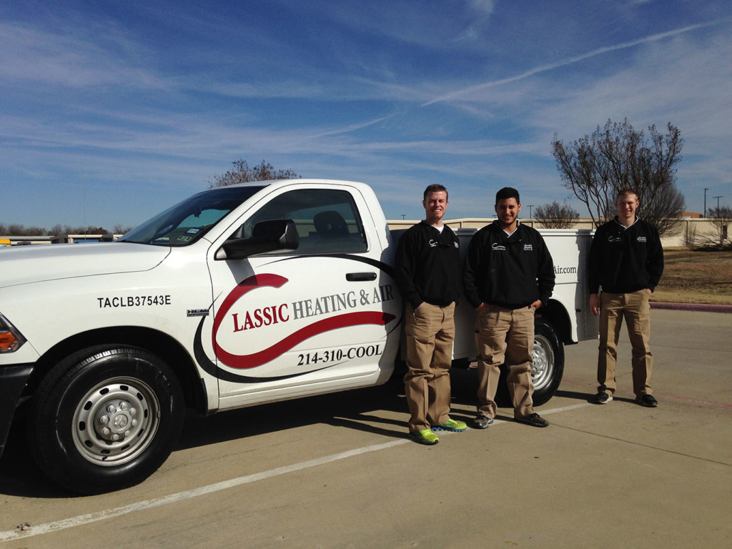 3 men in Classic Heating & Air uniform posing next to Classic Heating & Air white pickup truck