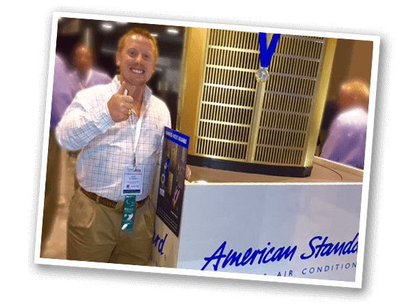 guy standing beside american standard hvac system